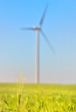 Wind turbines on Green wheat field Stock Photo