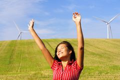 Wind turbines and happy woman. Wind turbines. Beautiful woman by wind turbines in Denmark Royalty Free Stock Photo