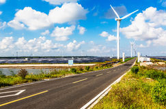 Wind turbines highways Stock Images