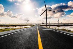 Wind turbines highways Stock Photography