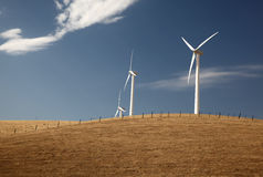 Wind Turbines on a Hill. With pretty clouds in the sky Royalty Free Stock Image