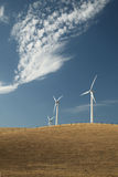 Wind Turbines on a Hill. With pretty clouds in the sky Stock Photos