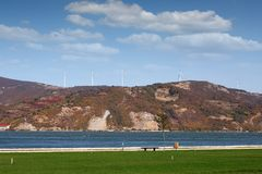 Wind turbines on the hill and Danube river landscape. Romania royalty free stock photography