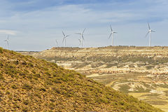 Wind turbines on the hill in front of blue sky Stock Image