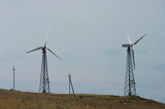 Wind turbines on a hill. Landscape with hills and wind turbines on background of sky Stock Image