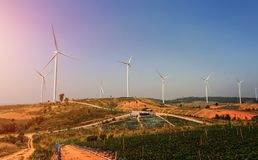 Wind turbines on the hill with sunset. Power energy Stock Image