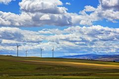 Wind turbines on a hill Royalty Free Stock Photos