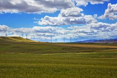 Wind turbines on a hill Stock Images