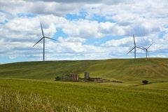 Wind turbines on a hill Royalty Free Stock Image