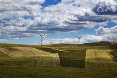 Wind turbines on a hill Stock Photography