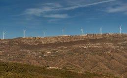 Wind Turbines on the hills generating power.  stock photo