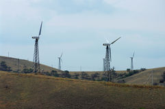 Wind turbines and the hills. Royalty Free Stock Photography