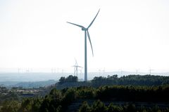 Wind turbines on hilltops, Catalonia, Spain. Wind turbines or an environmentally friendly wind farm stretching into the distance on Spanish hilltops, province of Royalty Free Stock Photo