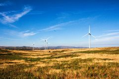 Wind turbines on hilly expanse create energy, Portugal Europe. Landscape from Portugal, Serra D`Aire. wind power plant clouds dark breeze draught nature royalty free stock photography