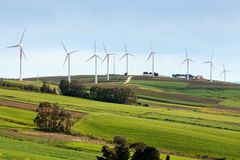 Wind turbines on hilly expanse Stock Photo