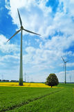 Wind Turbines In Green Meadows Royalty Free Stock Photo