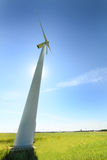 Wind turbines installed in the green field. Stock Images