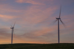 Wind Turbines in Iowa. Sunrise in Central Iowa, with a pair of wind turbines Stock Image