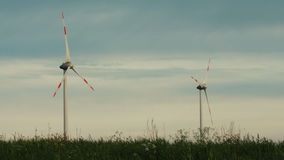 Wind turbines isolated on overcast sky background stock footage
