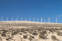 Wind Turbines in Jandia, Fuerteventura. Wind turbines in the desert of Jandia in Fuerteventura, Spain Royalty Free Stock Photo