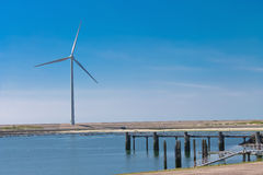 Wind turbines on the lake Royalty Free Stock Photo