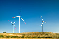 Wind turbines landscape. Wind turbines in a wind farm Royalty Free Stock Image