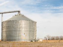 Wind turbines large grain bin Royalty Free Stock Photography
