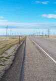 WInd Turbines line Pairie Road Royalty Free Stock Image
