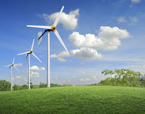 Wind turbines on meadow and sky Royalty Free Stock Images