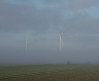 Wind Turbines in Mist Royalty Free Stock Photography