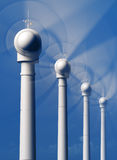 Wind Turbines in motion from the front Royalty Free Stock Images