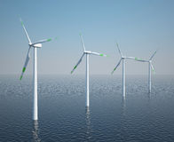 Wind turbines in motion on the ocean with blue sky Royalty Free Stock Image