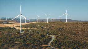 Wind turbines on mountain ridge. Blades rotate. Power, source green energy. Generating. Time lapse