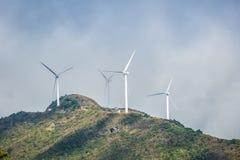 Wind turbines on the mountain top Stock Photo