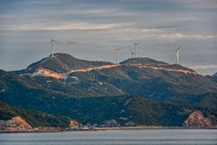 Wind turbines on mountain top Stock Photos
