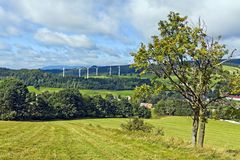 Wind turbines in mountains Stock Images