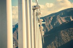 Wind Turbines and Mountains Stock Photos
