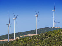 Wind turbines on mountaintop Royalty Free Stock Image