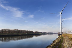Wind turbines near canal Hartel in Rotterdam Stock Images