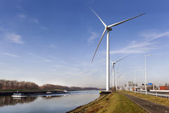 Wind turbines near canal Hartel in Rotterdam Royalty Free Stock Images