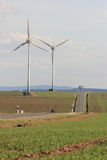 Wind turbines near a road Royalty Free Stock Photos