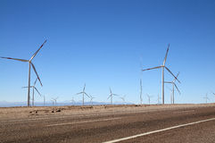 Wind turbines next to the road, Calama, Chile Royalty Free Stock Photos