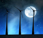 Wind turbines. In the night sky with moon Stock Image