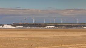 Wind turbines at the North Sea Coast, Hartlepool, UK. Wind turbines at the North Sea Coast of the North Gare Beach in Seaton Carew, Hartlepool, UK royalty free stock image
