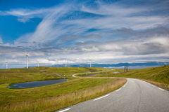 Wind turbines. Norway. Vagsøy. Modern windmills at the edge of world Royalty Free Stock Images