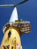 Wind Turbines. Offshore Turbines Climbing on the way to work Stock Photography