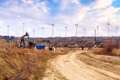 Wind turbines and oil pumps Royalty Free Stock Photo