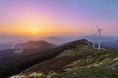 Wind turbines in Oiz eolic park. At sunset Stock Image