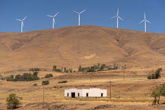 Wind Turbines and Old Building. Spanning 30 miles and offering a capacity of 500 megawatts, Windy Flats development is one of the largest wind energy projects in Stock Photos