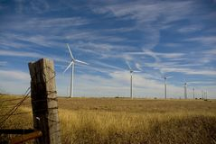 Wind Turbines and old fence post Royalty Free Stock Images